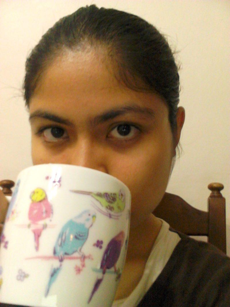 Jolynn enjoying a mug of plain water.